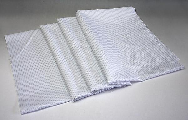 帯電防止クリーンルーム用巾着袋はクリーン生地の縫製品なので、静電気防止で粉塵やホコリの発生を防止します。クリーン作業服と同じ生地。