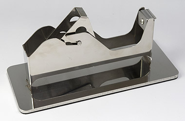 製薬工場用テープカッター台はSUS304ステンレス製で耐食性があり、錆びない食品工場やクリーンルーム向けのテープ台です。